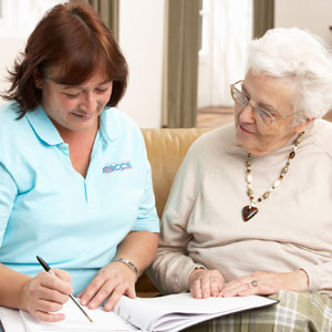 carer-with-old-women-with-papers